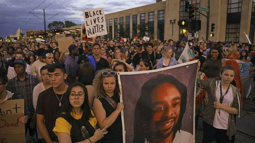Demonstrators march to remember Philando Castile. (AAP)