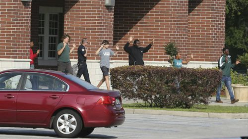 Students are led out of Forest High School with their hands up. (AP)