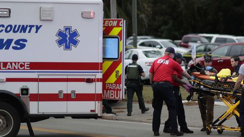 Emergency services at the scene of the shooting at the Hot Yoga studio in Florida.