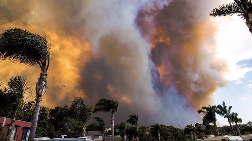 Tathra residents have described fleeing their homes on Sunday afternoon.