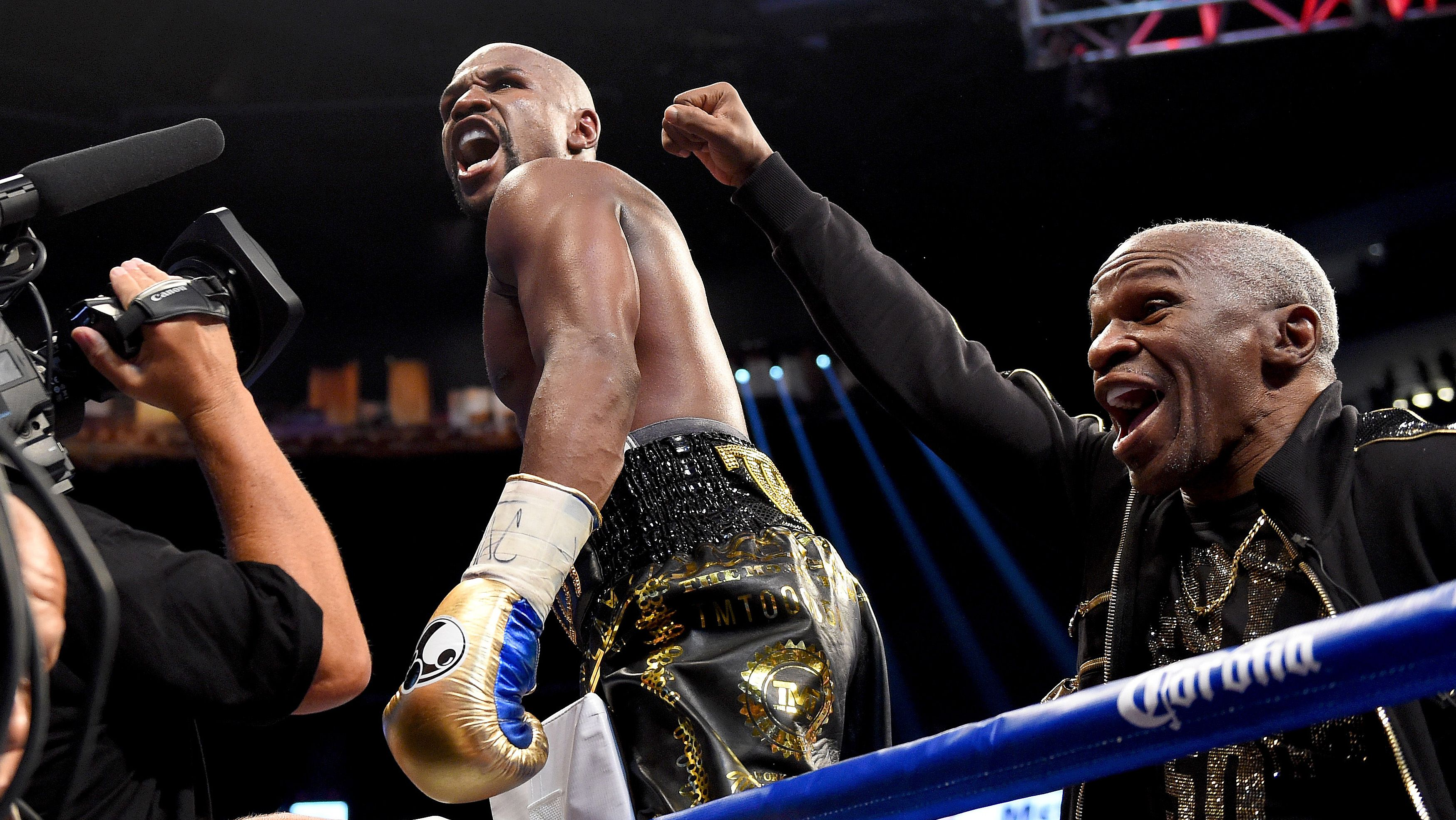 Floyd Mayweather defeats Conor McGregor in 10th round TKO