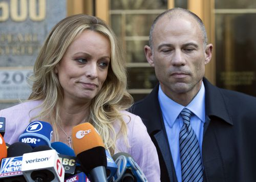 """dult film actress Stormy Daniels, left, stands with her lawyer Michael Avenatti as she speaks outside federal court, in New York. The Justice Department says Avenatti, made """"misrepresentations"""" in a bankruptcy case involving his former law firm that owes more than $440,000 in unpaid federal taxes. Avenatti said Wednesday, July 4, 2018, he doesn't owe any money personally and called the court filing """"politically motivated."""" (AP Photo/Mary Altaffer, File)"""