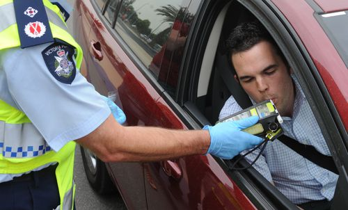 Police perform a random breath test (RBT) on a driver in the Docklands precinct in Melbourne. Picture: AAP