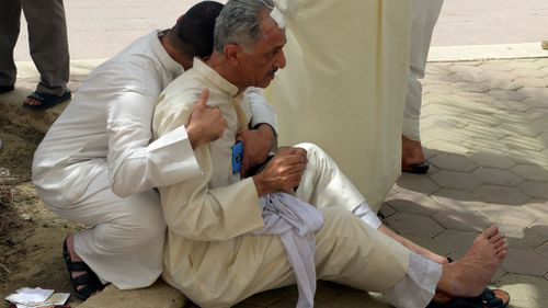 Kuwaiti worshippers react following a blast at Imam Sadiq Mosque. (AAP)