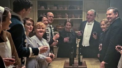 Downton Abbey the movie - downstairs group shot toast visit to King and Queen