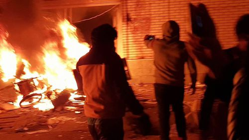 Iranian demonstrators set fire to the building of Hozeh Elmieh seminary in the Takistan in Qazvin, during protesting high prices. (AP)