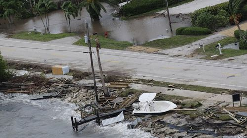 The Florida coastline after pounding seas and fierce winds ripped boats from their moorings. (AP)