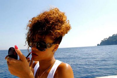 "Rihanna shares pics of her vacation sailing around the coast of Italy.<br/><br/>""RedLipstick all on da paper"""