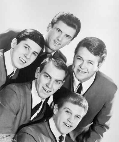 """Dick Peterson, Mike Mitchell, Norm Sundholm, Lynn Easton and Barry Curtis of the rock and roll group """"The Kingsmen"""" pose for a portrait in circa 1964."""