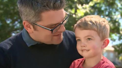 Simon Adam with son, James, whose life was saved by donated platelets.