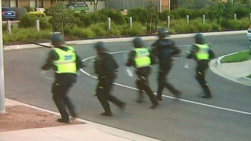 Police prepare to confront the partygoers. (9NEWS)