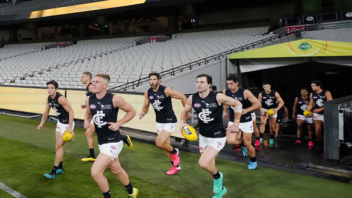 Blues players enter the arena during the Round 1 AFL match
