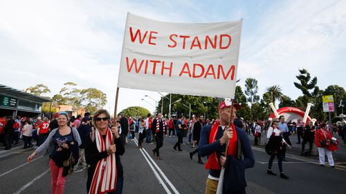 Swans fans arriving at the SCG with banners. (AAP)