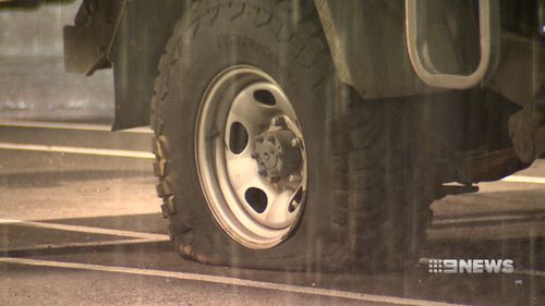 The car's tyres were shot by police. (9NEWS)