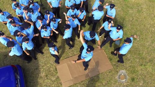 """Denver Police Department members """"dance it out"""". (YouTube/Denver Police)"""
