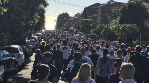 White Ribbon Day: Sea of white as marchers pledge to end domestic violence