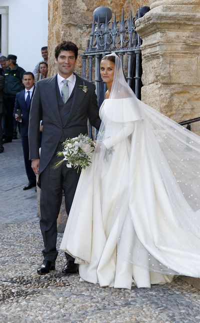Lady Charlotte Wellesley, a descendant of Queen Victoria, married New York financier Alejandro Santo Domingo in Íllora, Spain over the weekend. Wearing an off-the-shoulder Emilia Wickstead gown and cathedral veil, Wellesley tied the knot in front of a host of notables, from the Duchess of Cornwall Camilla Parker Bowles to singer James Blunt and model Eva Herzigova.