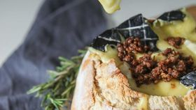 Woombye Ash Brie baked sourdough loaf with garlic rosemary and Voodoo Bacon Jam