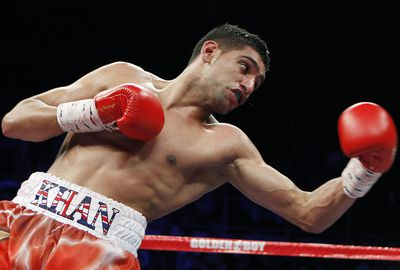 Amir Khan wore boxing shorts worth $36,000 in a bout in 2014. (AAP)