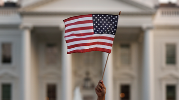 File photo:  An American flag is waved during a rally outside the White House, in Washington, Monday, Sept. 4, 2017. (AP Photo/Carolyn Kaster)