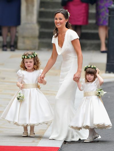 Pippa Middleton holds hands with Grace Van Cutsem and Eliza Lopes as they arrive to attend the Royal Wedding of Prince William to Catherine Middleton at Westminster Abbey on April 29, 2011.