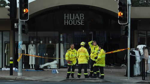 NSW fire department stand in front of the shop Hijab House in Sydney where a car drove into the shop, injuring twelve people including the driver.