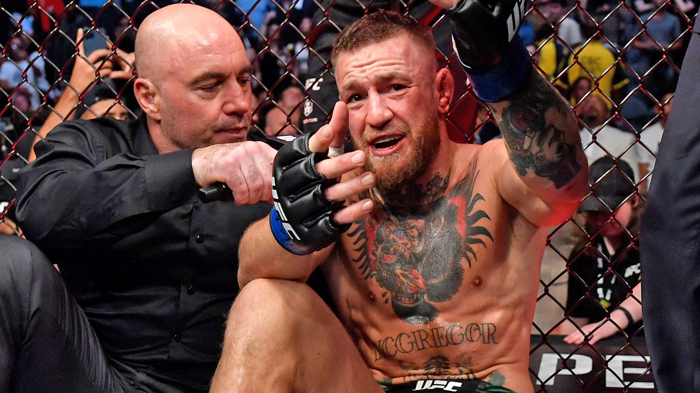 Conor McGregor of Ireland is interviewed by Joe Rogan after his loss to Dustin Poirier