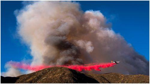 An air tank drops fire retardant over the Blue Cut wildfire. (AFP)