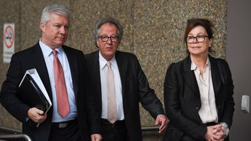 Australian actor Geoffrey Rush (centre) arrives at the Federal Court in Sydney Monday, October, 29, 2018.