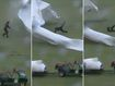 Hapless groundsman sent sprawling by flying pitch covers