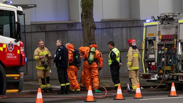 HAZMAT crews at the Garvan Institute in Sydney (Louise Kennerley).