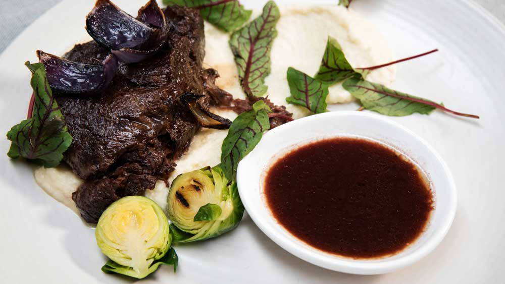 The Butler's Twice cooked Beef Cheek on celeriac puree with slow roasted onions and grilled sprouts