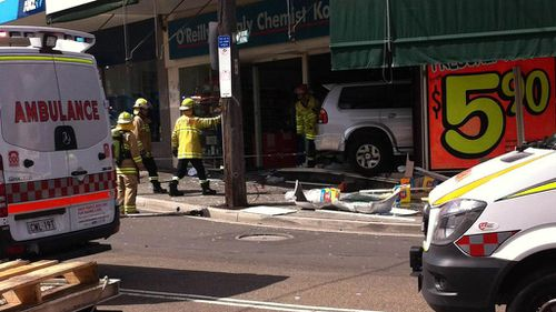 The car seen after crashing through the pharmacy window. (9NEWS)