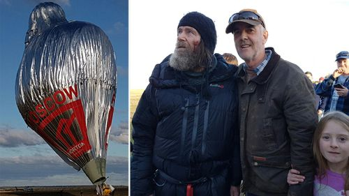 The balloon landing, and Fedor Konyukhov (left), among crowds on the ground. (Supplied)