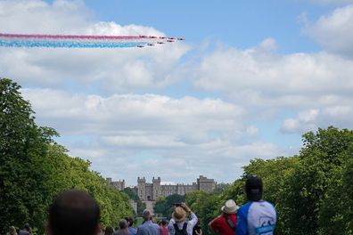 The Red Arrows fly over Windsor Castle to mark the official birthday of Queen Elizabeth.