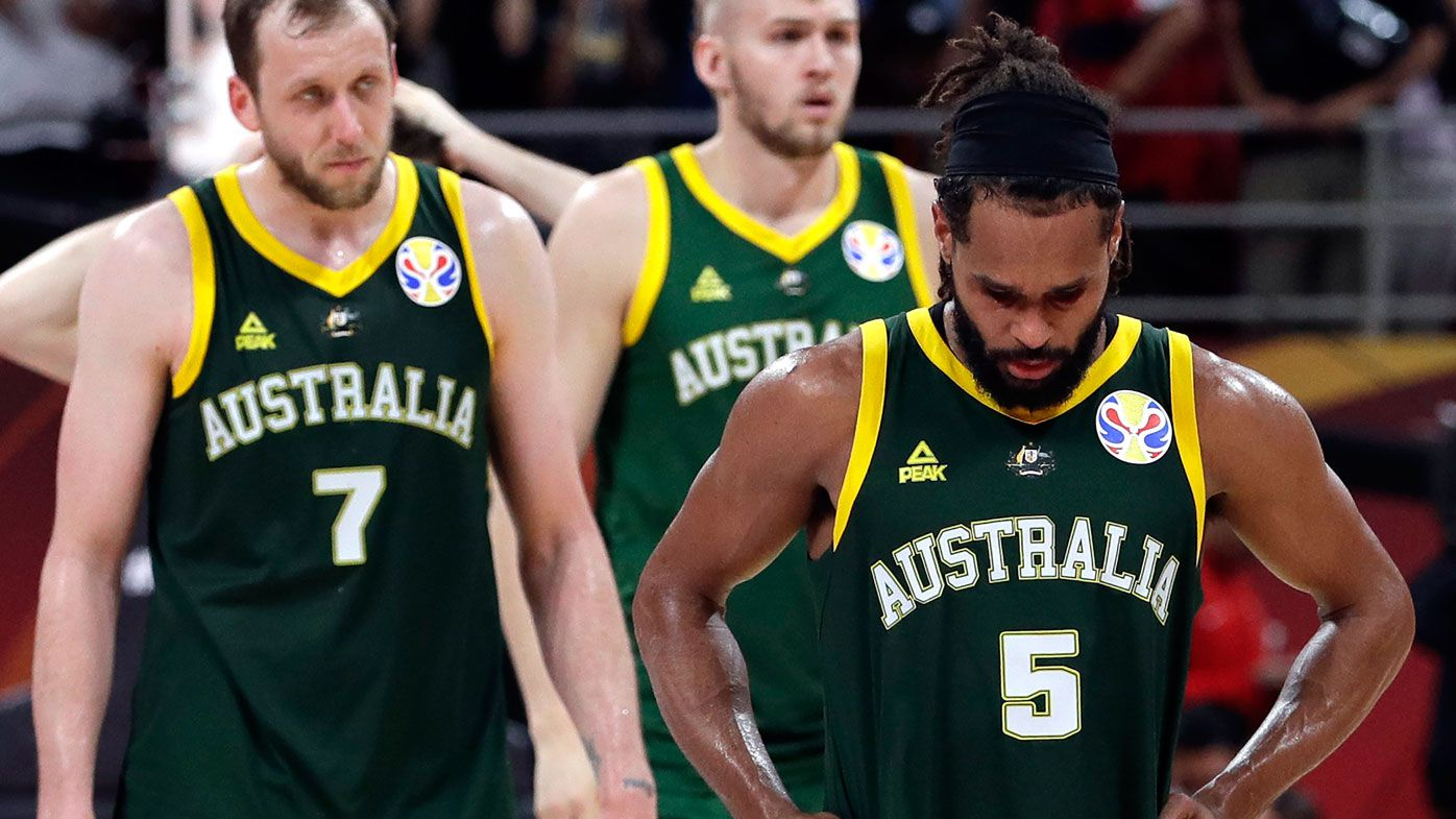 Joe Ingles, left, and Patty Mills of Australia react after their double overtime loss