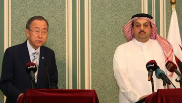 UN Secretary-General Ban Ki-moon with Qatari Foreign Affairs minister Khaled al-Attiyah during a press conference as part of renewed cease fire efforts in Doha, Qatar. (AAP)