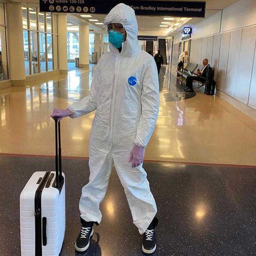 Naomi Campbell wears full hazmat jumpsuit to airport.