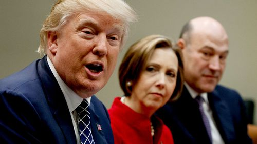 US President Donald Trump (left) and head of the White House national economic council Gary Cohn (far right). (AAP)