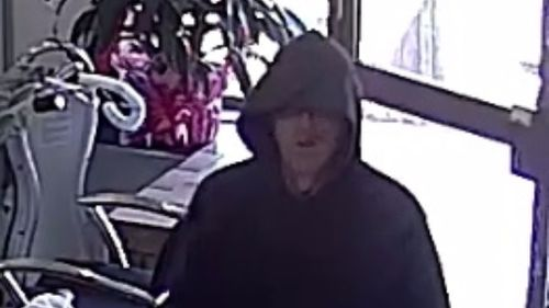 CCTV shows the offender enter the St Albans salon. (Victoria Police)