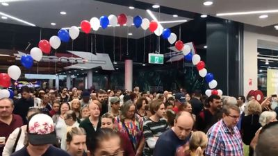 Large crowd storms new Kmart store