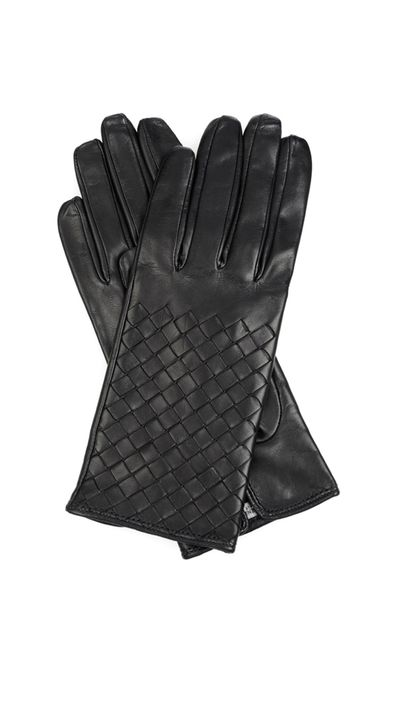 "<a href=""http://www.matchesfashion.com"" target=""_blank"">Gloves, $400, Bottega Veneta at matchesfashion.com</a>"