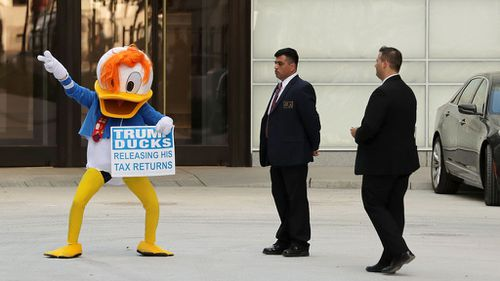 Donald Trump has accused Hillary Clinton of breaking the law with Donald Duck stunt.