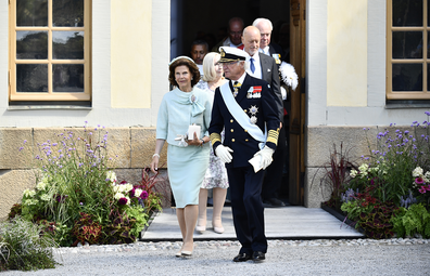 Sweden's Queen Silvia and King Carl Gustaf leave, after the Christening ceremony of Prince Julian, at the Drottningholm Palace Chapel, in Stockholm, Sweden, Saturday, Aug. 14, 2021.