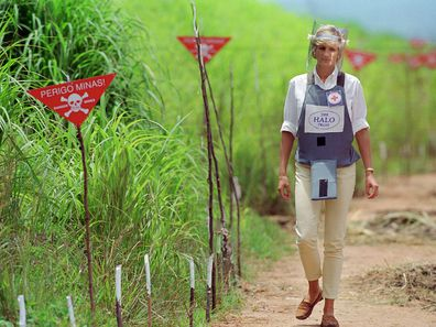Princess Diana walks through a cleared landmine field in Angola, 1997.