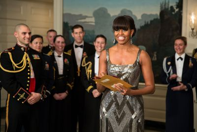 <p>The First Lady chose a custom-made metallic art-deco style beaded gown by Naeem Khan when she appeared on live feed to announce Argo as the winner of Best Picture during the Academy Awards.</p> <p>Image: Getty.</p>