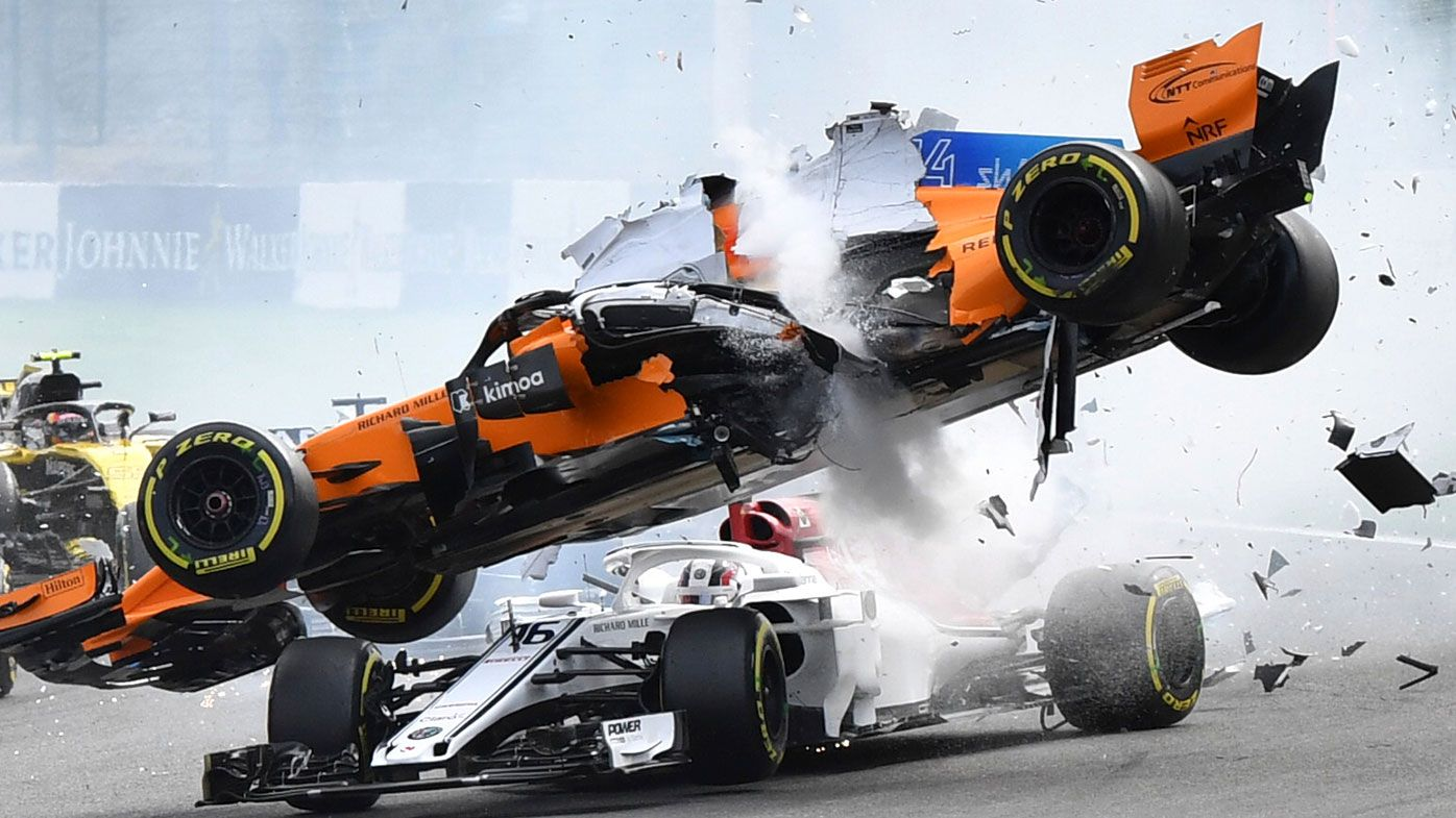 Charles Leclerc is hit by Fernando Alonso at the start of the Belgian Grand Prix.
