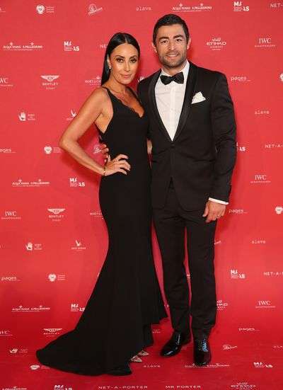 "Terry Biviano in <a href=""https://www.rebeccavallance.com/"" target=""_blank"">Rebecca Vallance</a> and Anthony Minichiello at the 2018 MAAS Centre for Fashion Ball"
