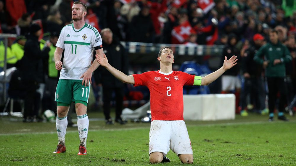 Switzerland qualify for World Cup finals against Northern Ireland after dubious first-leg penalty