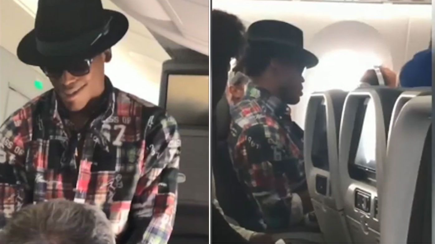 Panthers quarterback Cam Newton offers a passenger money to switch seats